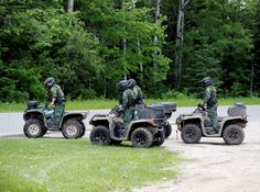 Law enforcement officers on all terrain vehicles pull out of the parking lot of a restaurant as the search for two escaped prisoners from Clinton Correctional Facility in Dannemora continues, on Monday, June 22, 2015, in Mountain View, N.Y. manhunt for two convicted murderers has jumped from a railroad line near the Pennsylvania state line to a hamlet in far northern New York not far from the prison they escaped from more than two weeks ago.  -  © AP Photo/Mike Groll