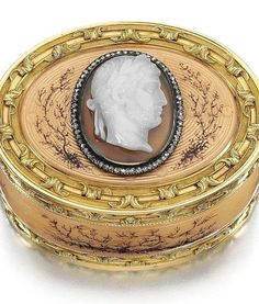 FABERGÉ~ JEWELED GOLD, ENAMEL AND AGATE BOX, WORKMASTER MICHAEL PERCHIN, ST PETERSBURG, 1895-1899 in 18th century Parisian taste, oval, the surface enamelled in translucent peach and painted with dendritic tendrils over engine-turned reeding interspersed with pellets, the two-colour banded gold borders chased with undulating acanthus leaves on sablé grounds, the lid set with an agate cameo,