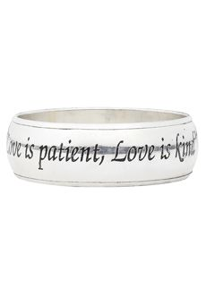 "Trades of Hope - ""Love is patient, Love is kind"" inscribed in English on one side and on the other is Hindi. The inside has a little heart cut-out. The Bangle is 1in wide. A silver colored alloy metal bangle. Made in India"