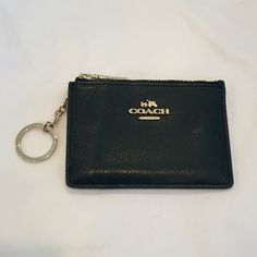 Coach Card Case- Black Authentic Coach Card Case. Spots for cards, clear window on the back for an ID. Attached key ring so you can attach to a lanyard or to your keys. Black cross grain leather. No flaws, barely used! Coach Bags Wallets