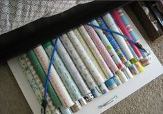 Transform a piece of wood, a cabinet pull, and some bungee cords into an efficient under bed storage system for all of your wrapping paper.