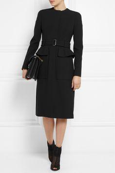 Alexander McQueen coat, dress and bag, Maiyet ring, Dolce & Gabbana boots.
