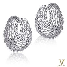 A unique style of diamond hoop earring by the Adornologist.