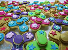 A sea of fidget spinner cookies by Wish I Had A Cake - they actually spin