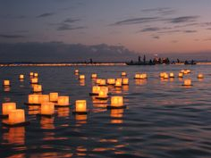 Paper lanterns float out to sea during Obon or the Festival of Lanterns, a Buddhist celebration usually held in July in Japan. The Japanese believe that during this period the souls of their ancestors return to their homes on earth. This is the time when people can guide and help their ancestors' spirits to find peace.