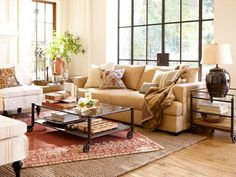 the cream sofa pops out with the pale walls & love the large vessel lamp. Could spray paint one that Mom has