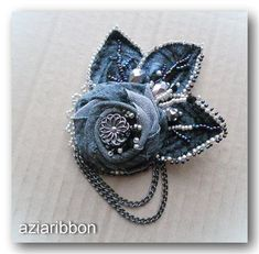 Brooch from the leftover pieces of denim from re-purposed jeans. Idea for handmade flower - love the beaded fabric leaves. images attach d 1 131 357 Denim Flowers, Cloth Flowers, Shabby Flowers, Fabric Roses, Leather Flowers, Fabric Ribbon, Brooches Handmade, Handmade Flowers, Handmade Jewelry