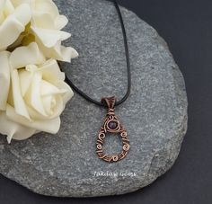 Handmade Amethyst and Copper Pendant on Leather Cord door JakdawGems