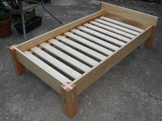 poplar frame, douglas fir posts, & slats from Ikea. sized to fit a crib mattress. Bed Frame Plans, Diy Bed Frame, Wooden Bed Frames, Wood Beds, Woodworking Bench Plans, Woodworking Projects, Woodworking School, Router Woodworking, Woodworking Workshop