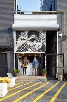 Steven Fong Architect has teamed up with design entrepreneur Alan and Lorne Gertner's lifestyle brand Tokyo Smoke to turn a small gap between two converted warehouse buildings into a coffee shop and showroom.