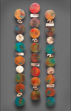 """totem to the wall. """"Circle Stick in Teals and Red"""" Rhonda Cearlock. Textured clay pieces that are pit-fired in sawdust and finished with acrylic paint. mounted on wood, ready to hang. A simple feather dusting. Sold in a group of three. Dimensions: 33.0in H x 3.0in W x 1.0in - $370.00:"""
