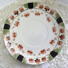Orange rose flower and black trellis vintage dessert plate by Royal Stafford China Striking in bold colors and probably 1930s to 1950s of age