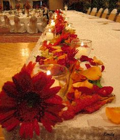 this picture quality is bad but I love the leaves on the edge of the head table with the little votive candles :)