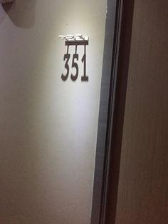 hotel door My Hotel Room Number Is Created By A Shadow Hotel Corridor, Hotel Door, Room Door Design, Hotel Room Design, Door Signage, Exterior Signage, Door Numbers, Shadow Art, Signage Design