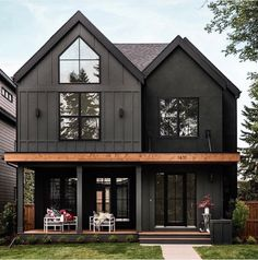 Delightful dark modern two story farmhouse with just a hint of contrast in the cedar beam. Large black windows and dutch doors bring the outdoors indoor and create an inviting family home. House by Trickle Creek Custom Homes. Black House Exterior, House Paint Exterior, Exterior House Colors, Exterior Homes, House Exterior Design, Exterior Siding, Interior Design, Home Siding, Black Windows Exterior