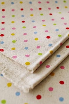 Polka dot patterns - Japanese fabric - Dots are a great print with a huge amount of scope for changing the design. for example having a single colour or a mixture of sizes of dots or even placing a shape in the middle of the circle