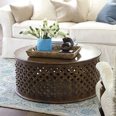 With its lower profile and crowd-serving size, this textured coffee table is great for family room sectionals and big seating groups. The airy latticework design is hand carved from solid mango wood with rivet details. Add a 36€ glass top (sold separately below).Bornova Coffee Table features: Rich 3-dimensional textureFully assembled