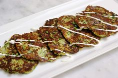 Zucchini Latkes, Four Seasons Hotel Las Vegas Makes 12 latkes Sour Cream topping ingredients: 1 cup (230 g) sour cream or plain full-fat yogurt 2 tbs. (29.6 mL) fresh lemon juice 1/4 tsp. (0.30 g) lemon zest 1 small clove garlic, minced Pinch of salt Method: 1. Put all of the ingredients in a bowl and mix well. Cover and refrigerate until ready to serve. Latke Ingredients: 2 pounds (907.2 g) zucchini, shredded Kosher salt 4 oz. (113.4 g) shredded white onion 2 oz. (56.7 g) grated…