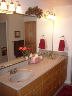 Bathroom Remodel: Jack and Jill sinks with double light sets and wooden cabinets