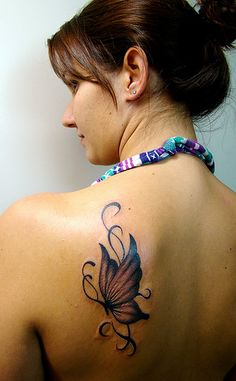 Google Image Result for http://tattoooz.com/wp-content/uploads/2012/07/Tribal-Tattoos-For-Women1.jpg