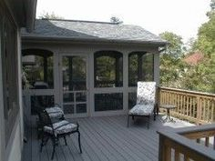 This is a very neat screened-in porch that is built on a deck. The curved screen panels add a very nice touch.