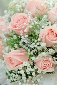 Close up shot of pink bridal bouquet made of pink roses and baby's breath