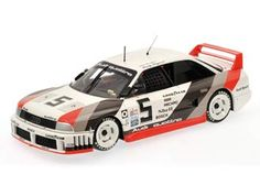 This Audi 90 Quattro (IMSA GTO Class Road America 1989) Diecast Model Car is White and Grey and features working steering, suspension, wheels and also opening bonnet with engine, boot, doors. It is made by Minichamps and is 1:18 scale (approx. 24cm / 9.4in long).    The Audi 90 Quattro IMSA GTO (internally called R5) is a race car that was used in the 1989 American IMSA GTO series. Prior to 1989 he achieved victories in rallye sport as well as the overall championship in the 1988 US Trans AM…