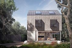 The form of this new build house in Essex draws from the surrounding housing typologies of traditional pitched roofed properties and timber barns. The detailing is contemporary with frameless glass bays and herringbone cladding. The site offers a fantastic woodland environment and the design was...