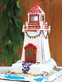 Gingerbread Lighthouse—To create a dramatic seascape, build and decorate the lighthouse on an inverted x L) cake pan set on a foil-lined baking sheet or large cake board. Tropical Christmas, Beach Christmas, Christmas Sweets, Christmas Cookies, Xmas, Christmas 2019, Christmas Gingerbread House, Gingerbread Man, Gingerbread Cookies