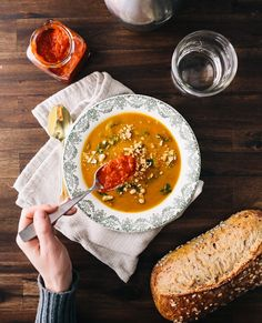 This vegan sweet potato soup recipe is full of flavor! Sweet potatoes, peanut butter and spices form the soup base, and it's topped with bright red harissa. Soup Recipes, Vegetarian Recipes, Recipies, Vegan Soups, Curry Recipes, Recipes Dinner, Harissa, Couple Cooking, Sweet Potato Soup