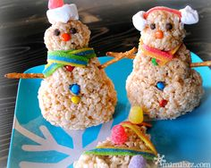 Rice Krispies Snowmen change it up from gingerbread houses. And I'm sure these will end up in tummies and not in the garbage.