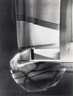 I love the bubbled shadow. Great photograph  by Minor White,  Windowsill Daydreaming  1958