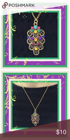 🌺🌴🌺 NWOT:  COLORFUL LEAF NECKLACE 🌺🌴🌺 🌺🌴🌺 The brilliant colorful rhinestones in this vintage looking necklace are all placed in a pattern.  That alone will draw much attention.  The gold and turquoise colors alone make this necklace pop.  Each side has four scalloped edges with one at the bottom for balance. 🌺🌴🌺 Jewelry Necklaces