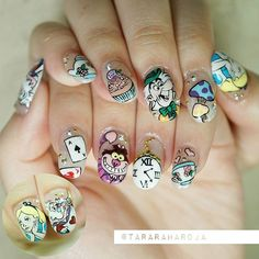 """""""We're all mad here""""   The super mainstream """"Alice in wonderland"""" nails for my super sistah @eugeniaverina ❤ ❤❤ all handpainted, no stickers  Lets see how long these"""