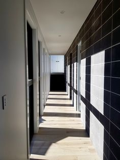 This wall will help heat the New England home throughout winter. Thermal Mass, Port Macquarie, New England Homes, Home Art, House Plans, Solar, This Is Us, Stairs, In This Moment