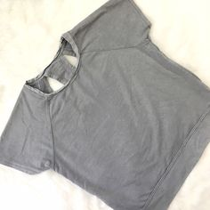 Calvin Klein Cut Out Athleisure Short Sleeve Back cut outs are SO on trend! Wear this piece over your yoga gear or pop it on with leggings for a comfy day look! No flaws, perfect condition. Calvin Klein Tops