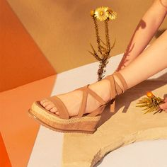 Keep wedges on-point with espadrille styling. This pair comes in a lush camel suede, with a flatform cork sole and ankle tie-up laces. Wear them with denim for a casual-cool vibe. #Topshop