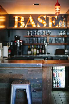 Metal bar top, wood base, lighted letters. Basecamp Hotel | South Lake Tahoe, CA