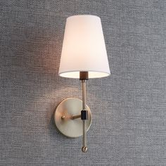 The Beatty Wall Sconce features a slender structure and simple shapes to form its contemporary design. Its white fabric shade and ball finial accent the vertical support, which holds a single bulb to illuminate your room. Mounting hardware is included for Bronze Wall Sconce, Wall Sconce Lighting, Wall Sconces, Pendant Lighting, Wall Lamps, Light Pendant, Half Bathroom Decor, Bathroom Interior Design, Bathroom Inspo