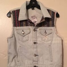 Forever 21 distressed vest size M Distressed vest with design from forever 21. Size medium. This vest is nwt but has a stain shown in pic 4. Price reflects Forever 21 Jackets & Coats Vests