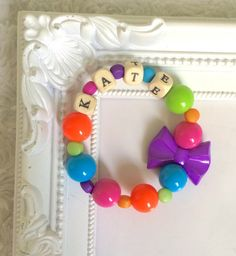 A personal favourite from my Etsy shop https://www.etsy.com/uk/listing/458762772/personalized-disney-bead-bracelet-for