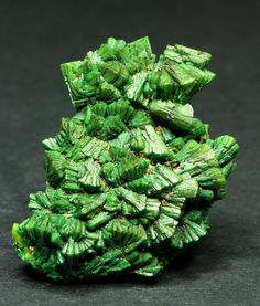 Torbernite. Cu(UO2)2(PO4)2 · 12 H2O