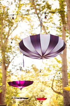 hanging parasols, photo by Jagger Photography http://ruffledblog.com/irvine-circus-wedding #circuswedding #weddingideas #decor