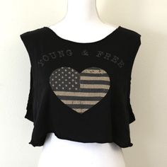 Young and free cut out tank size large // black muscle tee tank top with cutout caged back, front says young and free with the american flag in a  heart shape. super cute summer graphic tee. #rock #punk #america Rock Rose Classic Tops Muscle Tees