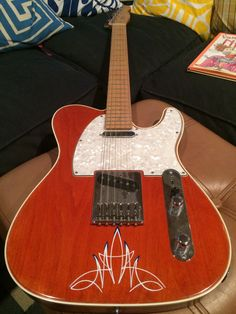 Custom Telecaster, handbuilt and finished by yours truly (pinstripes by Dave Lombardo)..
