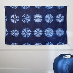 Shibori Tapestry. Re-vamp your walls with a touch of beachy bohemian flair. An easy way to add design to your favorite space, our Shibori Tapestry hangs from the wall to showcase your style.