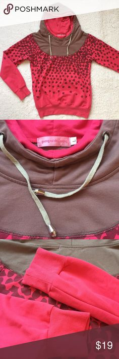 Pink and brown hoodie sweatshirt with pockets Pink and brown hoodie sweatshirt with side pockets. Hoodie things with metal stoppers. Ribbed cuffs and hem. Approx measurements taken flat: 19in bust and 22in long. Guang Rui Shi Zhuang Tops Sweatshirts & Hoodies