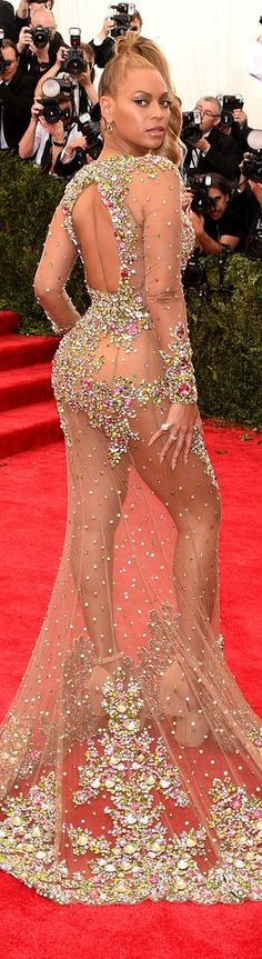 Beyoncé totally blindsided us by showing up late to the Met Gala in this stunning completely sheer bedazzled Givenchy number.