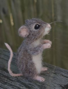 This will be delivered after Christmas 2017.A whimsical, yet realistic grey brown mouse created of wool and alpaca. This little mouse has a wire frame which allows him to be posed and his hands can hold small things. He is about 4 inches tall. He is perfect for adding to your home