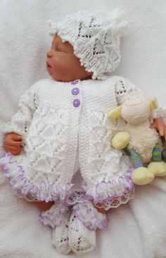 A baby knitting pattern for a girls lace sweater set hat Knitted Baby Clothes, Baby Doll Clothes, Lace Sweater, Sweater Set, Reborn Dolls, Reborn Babies, Baby Knitting, Crochet Baby, Lace Knitting Patterns